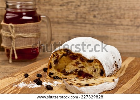 Stollen with dried fruits and nuts. Selective focus. - stock photo