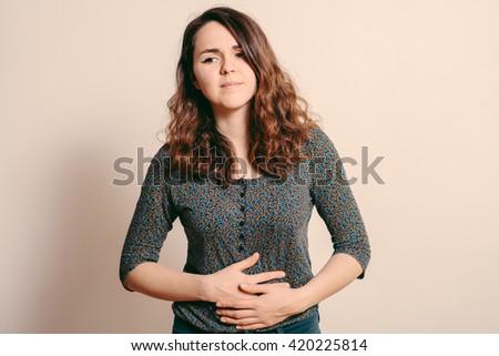 Stomach ache woman - stock photo
