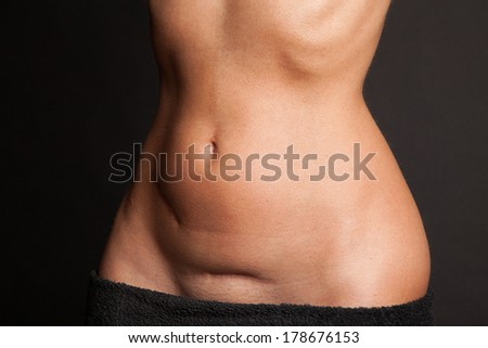 Stomach of a beautiful woman with scars
