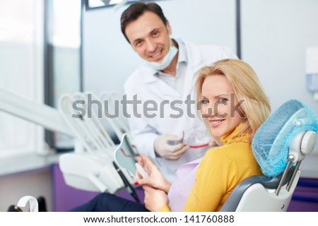 Stomatolog with patient in office - stock photo