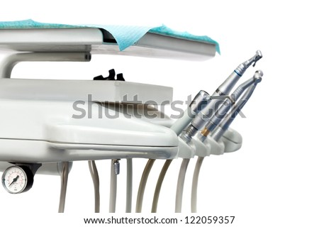 Stomatological instrument in the dentists clinic. isolated on white