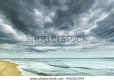 Stomy clouds over the beach, storm clouds above the sea