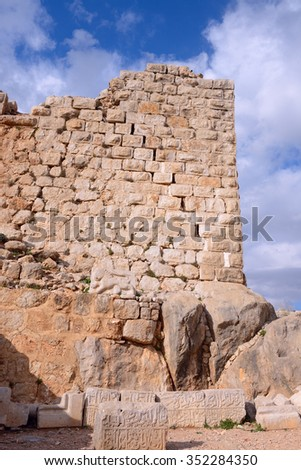 Stone ancient inscription from 1275, during the rule of the Mamluk Sultan Baybars. Golan heights, on a crest about 800 m high above sea level. National park, Israel - stock photo
