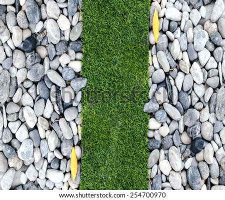 Stone and grass in garden - stock photo