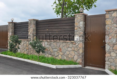 Stone And Metal Fence With Door Of Modern Style Design Decorative Cracked  Real Stone Wall Surface