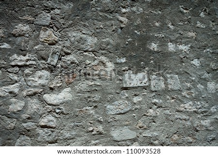 Stone and plaster wall texture background dark edged