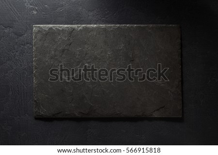 stone and slate on black background