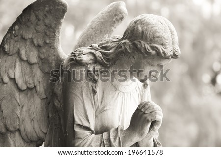 Stone angel in black and white - stock photo