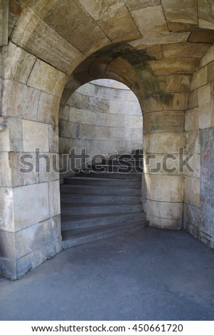 Stone arch and steps in castle. Medieval doorway. Spiral stairway  - stock photo
