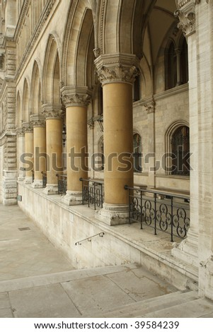 Stone archway with columns in old building - stock photo