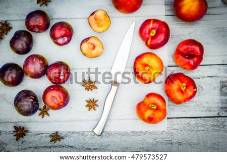 Stone Autumn fruit on the wooden table, flat view.