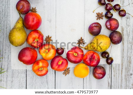 Stone Autumn fruit on the wooden table, top view.