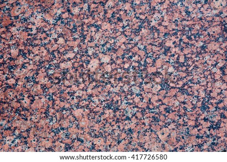 Stone Background of mottled red granite igneous rock, texture - stock photo