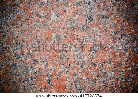 Stone Background of mottled red granite igneous rock with darkened edges, texture - stock photo