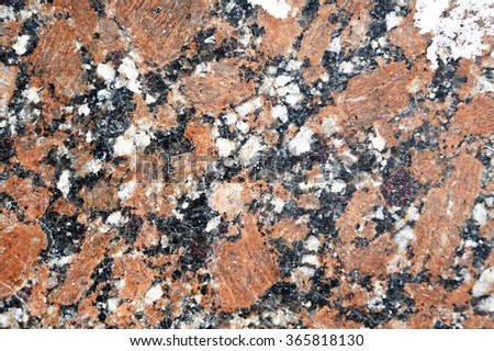 Stone background polished granite tiles. Closeup. - stock photo