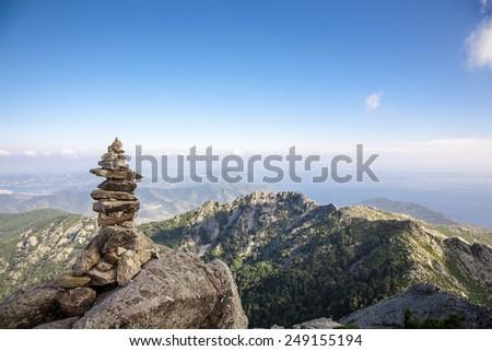 stone balancing on the mountain top - stock photo