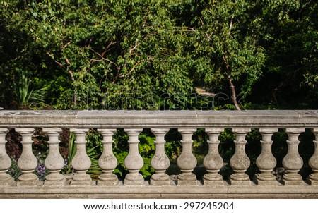stone banister to garden - stock photo