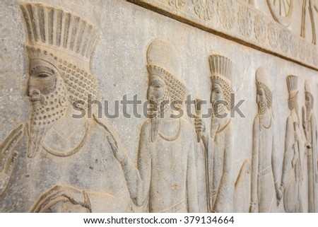 Stone bas-relief in ancient city Persepolis, Iran. - stock photo