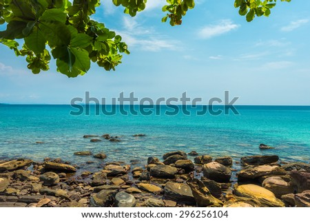 Stone beach landscape with blue sea
