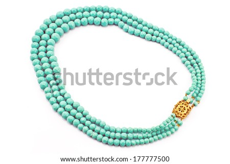 Stone beads necklace isolated on white  - stock photo