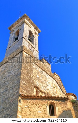 Stone belfry of Romanesque church in Chateauneuf-du-Pape, Rhone valley, France