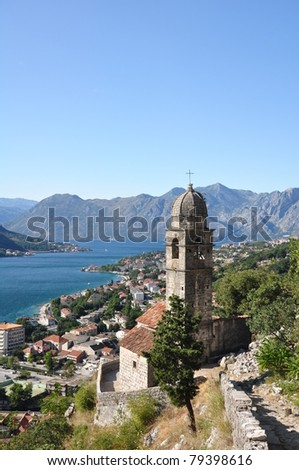 Stone bell tower of Chapel of Our Lady of Salvation above Kotor town and Kotor bay, Montenegro