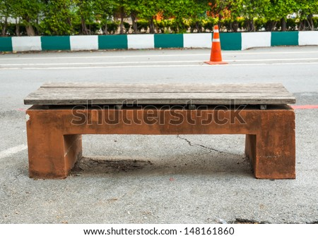 Stone Bench by side a road - Old stone park bench - stock photo