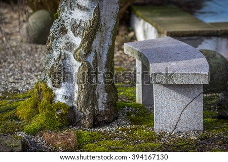 Stone bench in a garden - stock photo