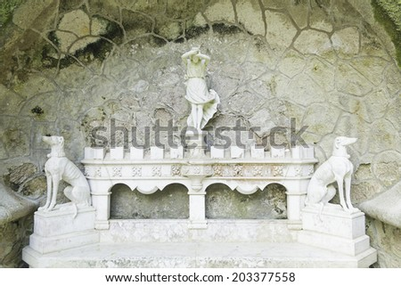 Stone Bench in sintra with wife and dogs, decoration  - stock photo