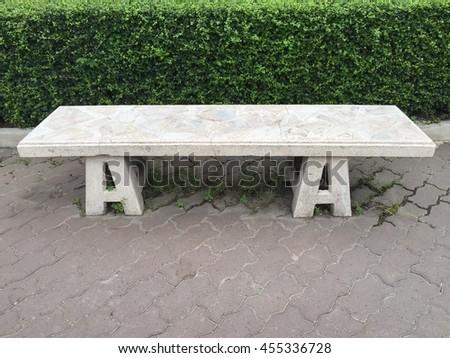 Stone bench in the garden. - stock photo