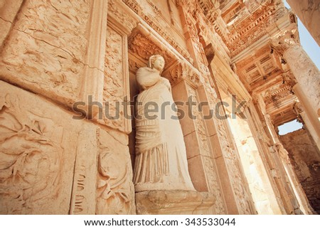Stone body of greek goddess at entrance of historical Celsus Library in Ephesus city, Turkey. Old greek city Ephesus founded on 10th century BC.   - stock photo