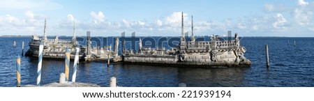 Stone breakwater barge at the Vizcaya Museum and Gardens on Biscayne Bay in the present day Coconut Grove neighborhood of Miami, Florida. - stock photo