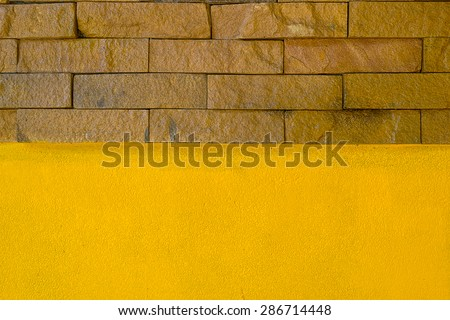 stone brick and yellow wall texture  - stock photo