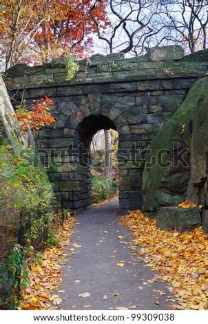 Stone bridge in Autumn in New York City Manhattan Central park. - stock photo