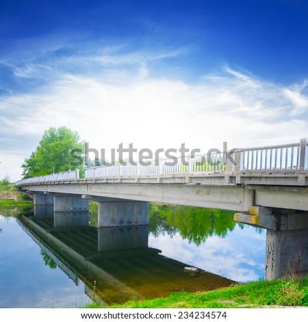 stone bridge over a river - stock photo