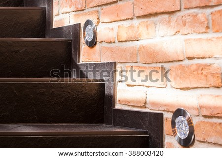Stone brown stairs and wall of red brick - stock photo