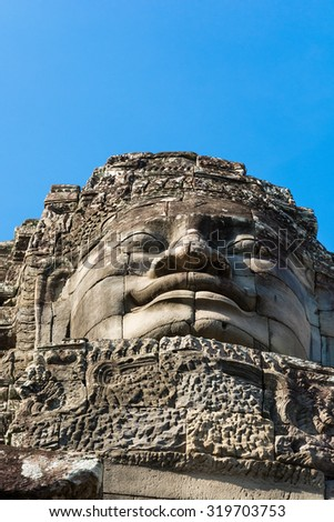 Stone Buddha head from below. Angkor wat. Cambodia