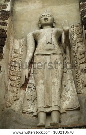 Stone Buddha on the wall, looking up, in Ayutthaya of Thailand - stock photo