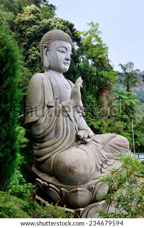 Stone buddha which is located at Chin Swee Caves Temple,Genting Highland - stock photo