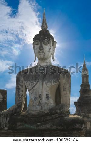 Stone Buddha with blue sky, Thailand - stock photo