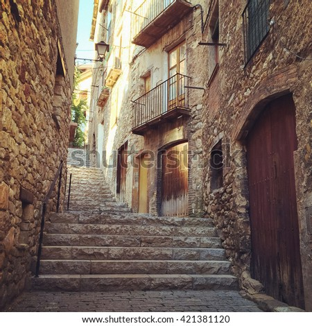 Stone buildings in historic town of Baga. Catalonia, Spain. - stock photo