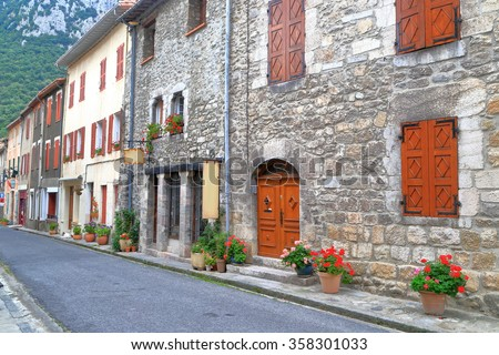 Stone buildings on a street from the old town of Villefranche de Conflent in the Conflent region of Catalonia, Pyrenees-Orientales department, France