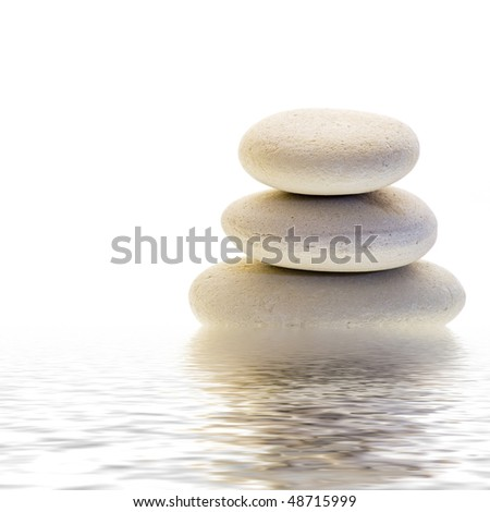 Stone cairn and water reflection