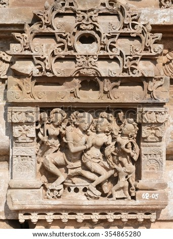 Stone carved erotic ancient sculptures at Historic Temple of Harshat Mata in Abhaneri, Rajasthan, India. The temple is from 8th - 9th Century, it was built by King Chand, it is world famous landmark - stock photo