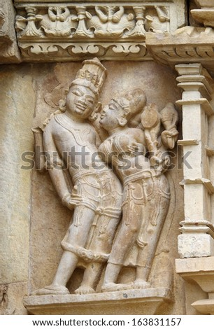 Stone carved erotic bas relief in Hindu temple in Khajuraho, India. Unesco World Heritage Site