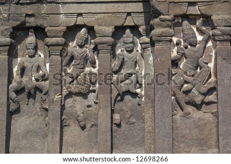 Stone carved statues on the front of the Kailas Hindu Temple at Ellora Caves, near Aurangabad, India. 8th Century AD