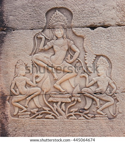 Stone carving Apsara in Angkor Wat temple at cambodia