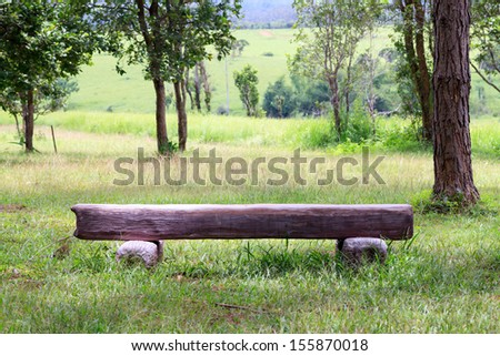 stone chair in the garden - stock photo