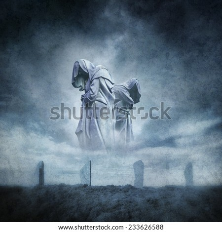 Stone circle ritual with two hooded figures materialising above an ancient megalithic monument against a dark, atmospheric stormy sky. - stock photo