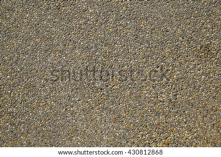 stone clad sidewalk, pebblestone sidewalk, Old Stone Country Road. Old Asphalt Road. Seamless Tileable Texture with Protruding Stones - stock photo